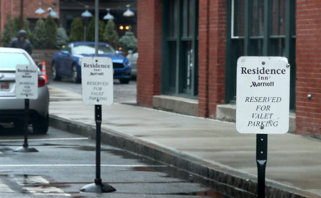Valet parking spaces are open at the Residence Inn Marriott in an empty Seaport District of Boston on March 19, 2020.