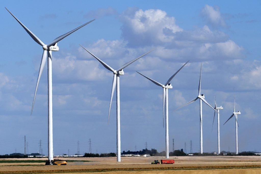 A wind farm in rural France utilizing renewable energy.