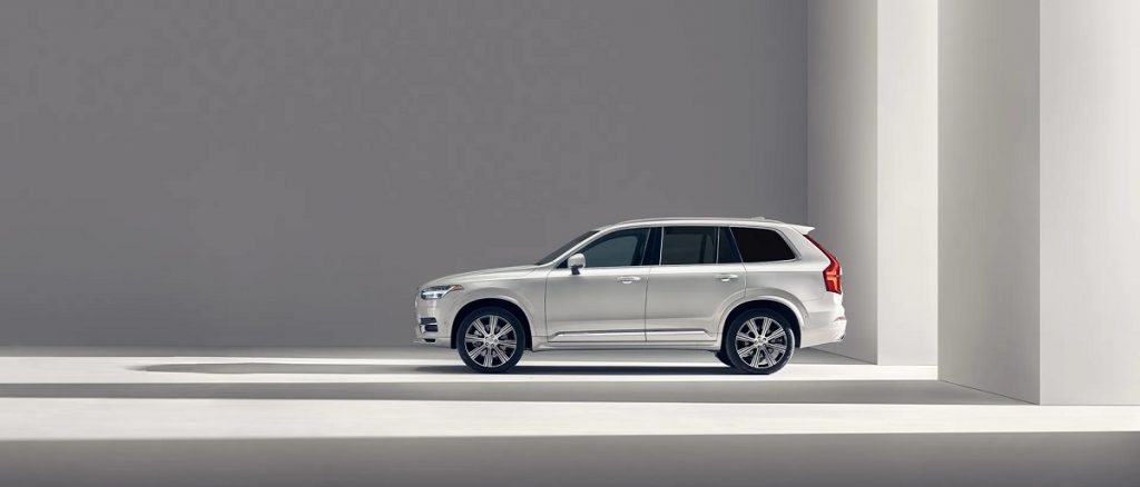 A white 2021 Volvo XC90 against a taupe background.