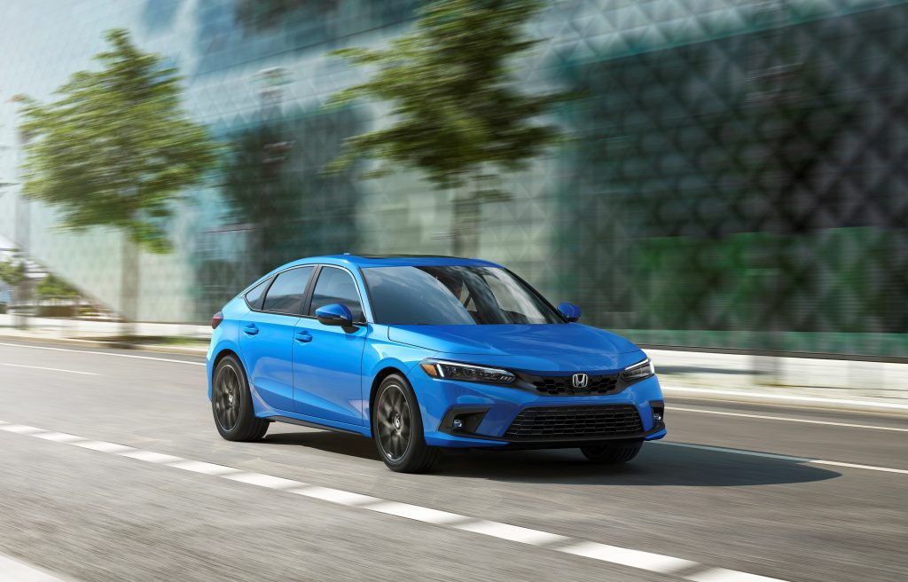 The new Civic in hatchback layout on a city street, seen here in blue