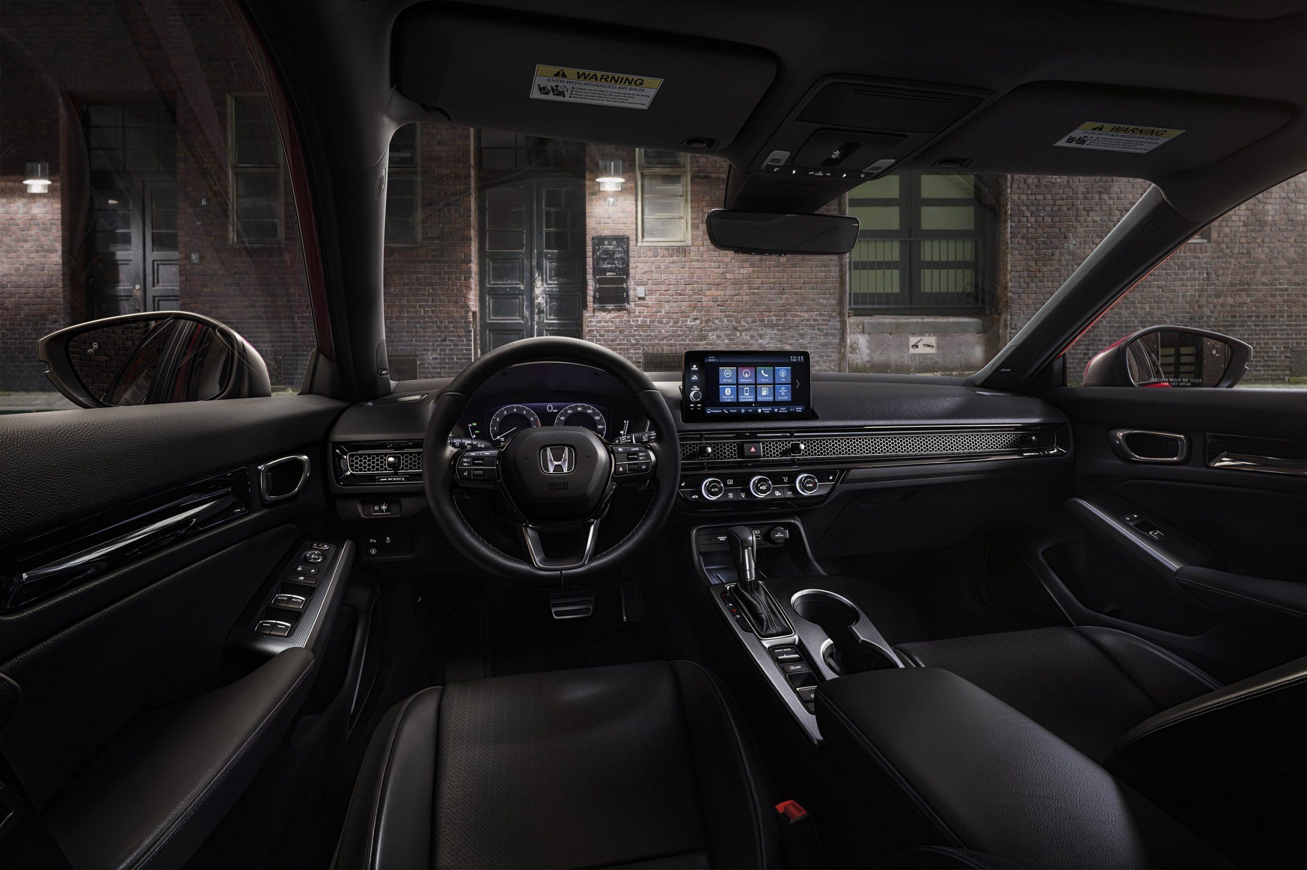 The 2022 Honda Civic interior shot from the driver's seat at night