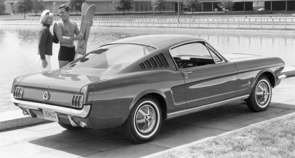 A 1965 Ford Mustang Fastback model in black and white
