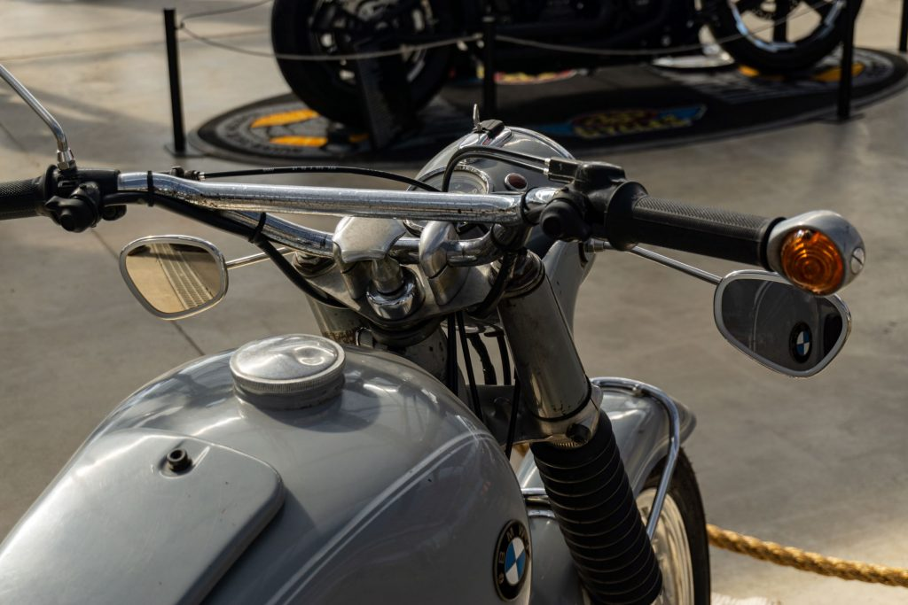 The rear view of a gray 1969 BMW R69 S's handlebars