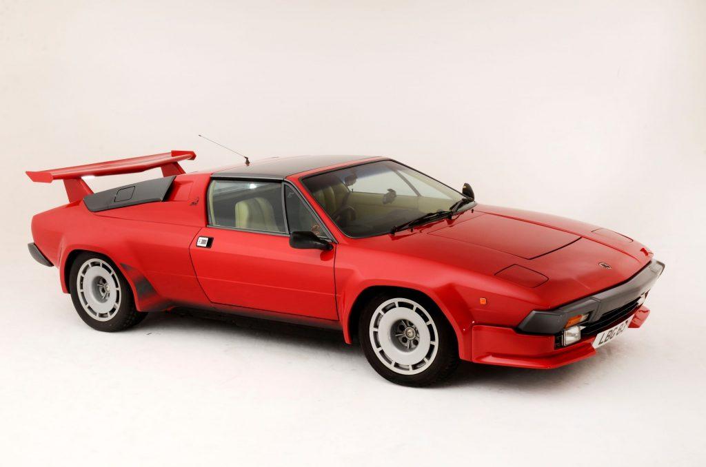 A red 1984 Lamborghini Jalpa S with a rear spoiler