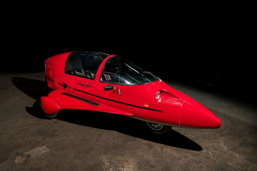 A red 1985 Pulse Litestar Autocycle