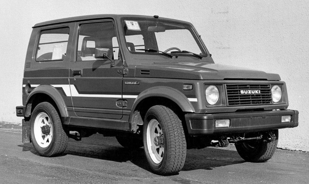 A 1986 Suzuki Samurai 4x4 parked by a building