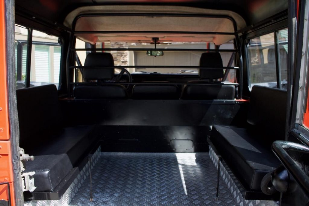 A rear view of a modified 1987 Land Rover 'Defender' 90's rear jump seats and front seats