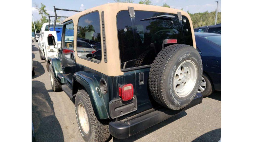 a green 1997 Jeep Wrangler TJ