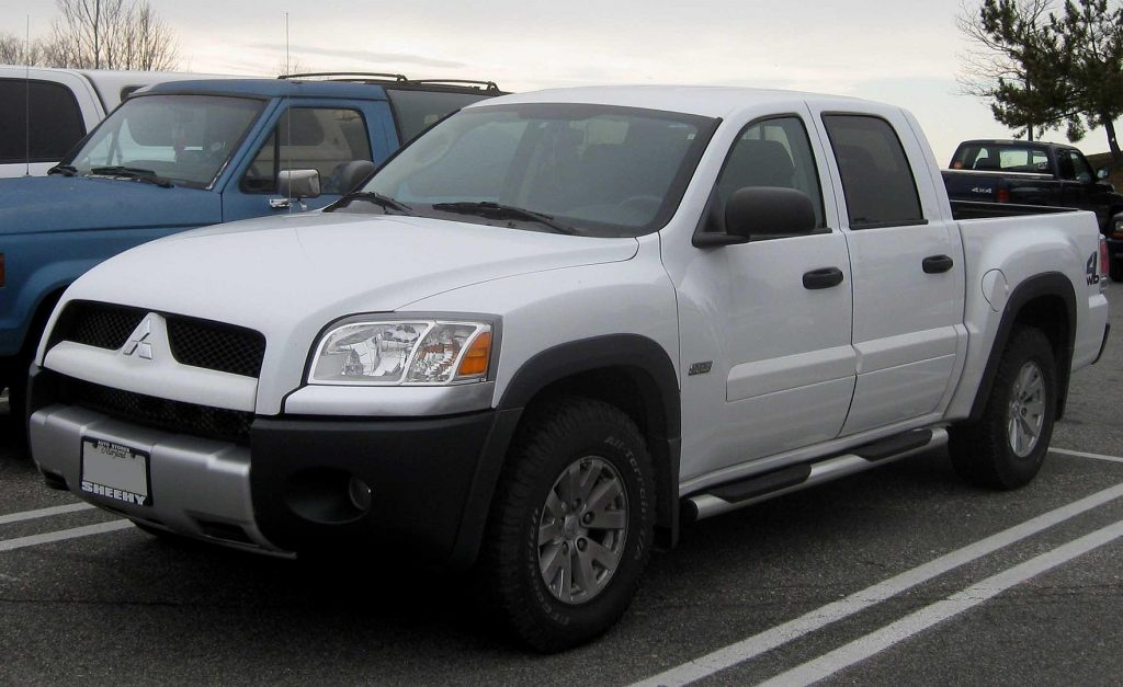 A silver 2006 Mitsubishi Raider parked in a parking lot