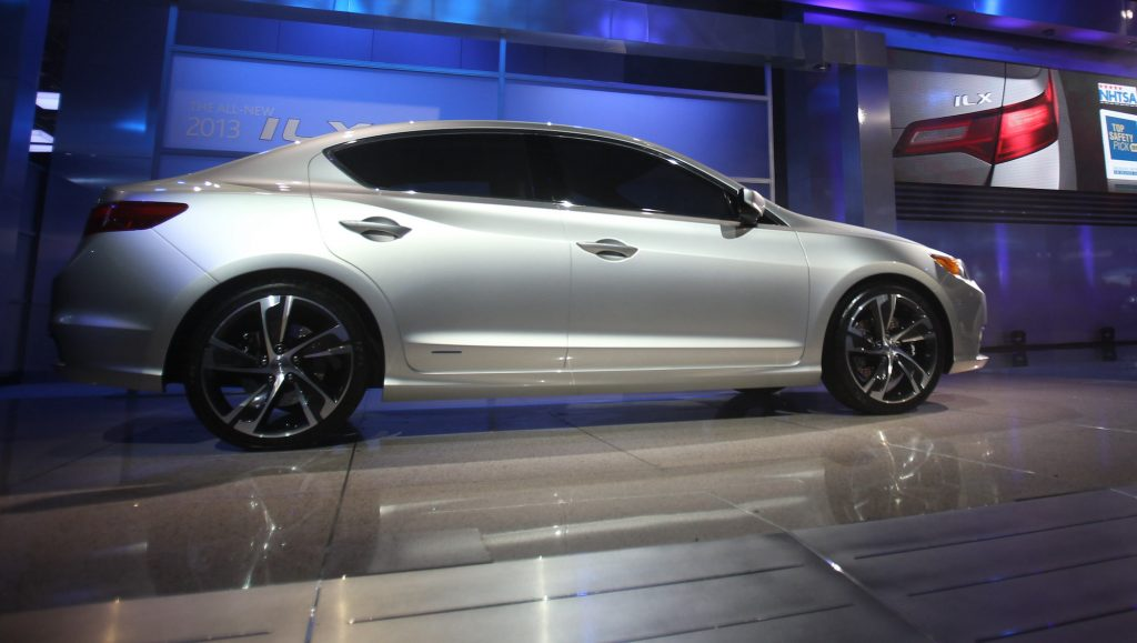 A silver 2013 Acura ILX compact sports sedan at the 2012 North American International Auto Show