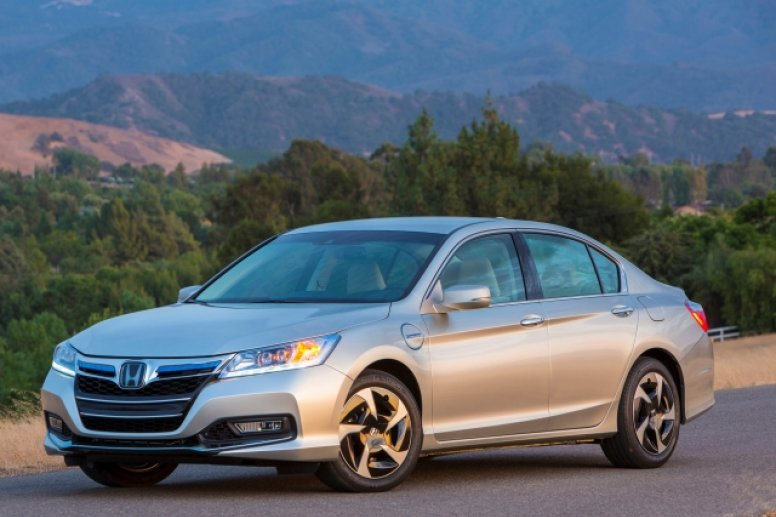 A silver 2014 Honda Accord parked on the side of a road at night.