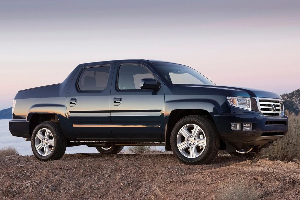 a black 2014 Honda Ridgeline parked on a hill - one of the best used pick up trucks under $20,000