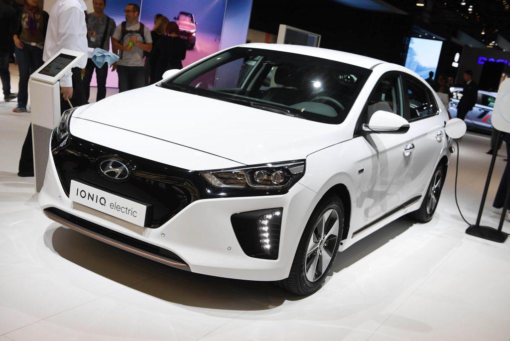 A white Hyundai IONIQ Plug-In Hybrid on the floor of Paris Motor Show, 2018.