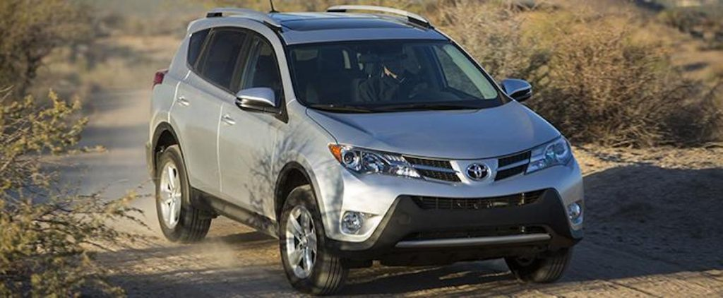 A 2015 Toyota RAV4 XLE parked on a dusty dirt road
