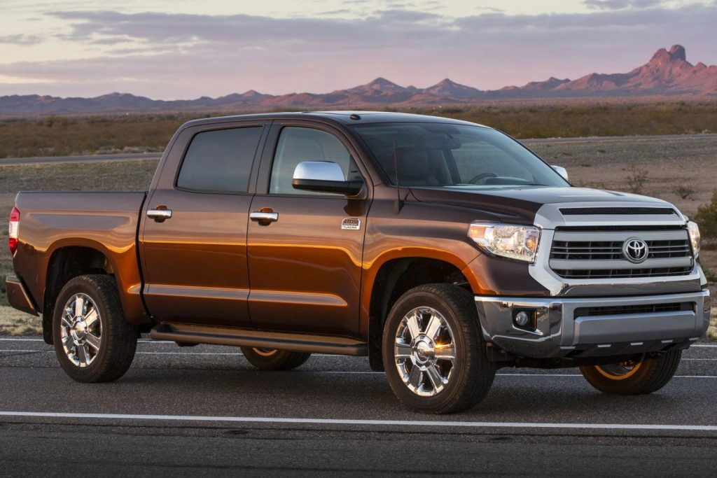 A brown 2015 Toyota Tundra parked during sunset - one of the best 5 used pickup trucks under $20,000