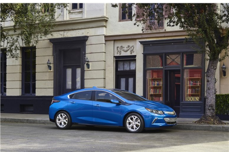 A blue 2016 Chevrolet Volt parked on the side of a road.