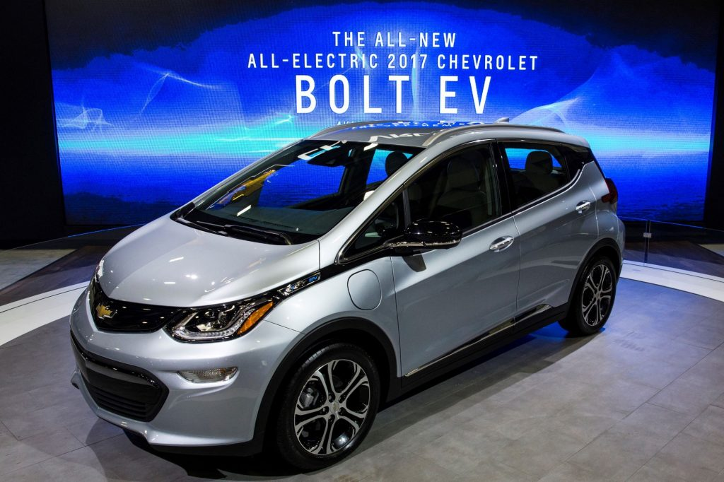 A silver 2017 Chevy Bolt, which has among those recalled, against a blue background with white print on it.