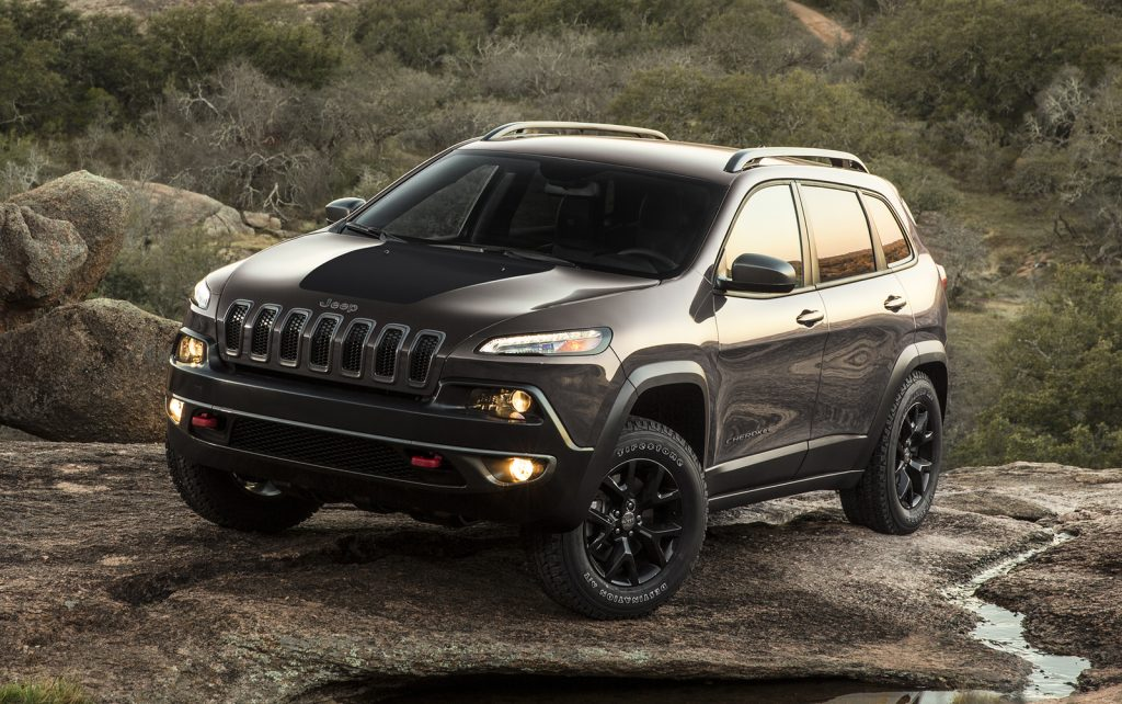 a gray 2017 Jeep Cherokee parked outside in dirt and water