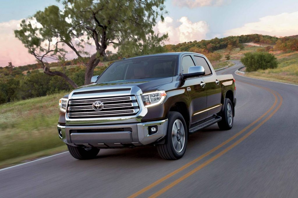 a brown 2018 toyota tundra drives down a winding road