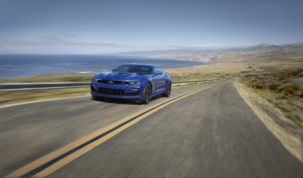 A blue Chevy Camaro on a road