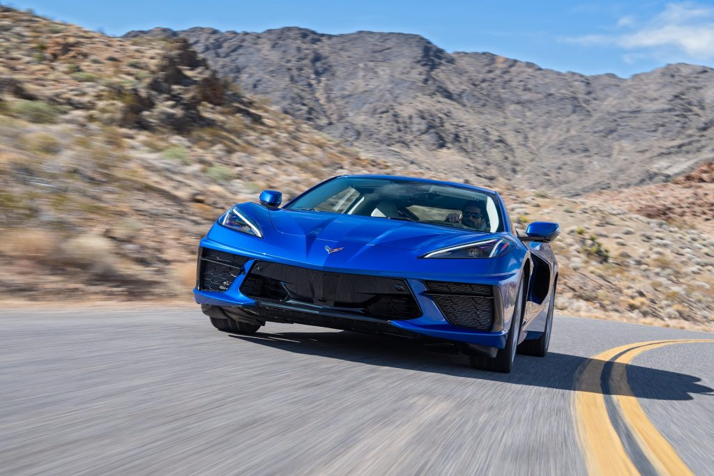This blue 2022 Chevrolet Corvette is a direct descendant of the Chevy Corvette Indy concept, seen here from the front on a canyon road