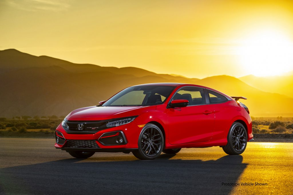 A red 2020 Civic Si coupe shot at sunset from the front 3/4 angle