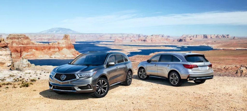 A dark gray and silver 2020 Acura MDX parked in the desert.