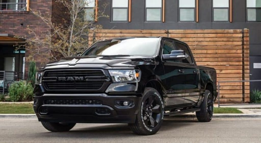 A black 2020 Ram 1500 parked outside of a house.