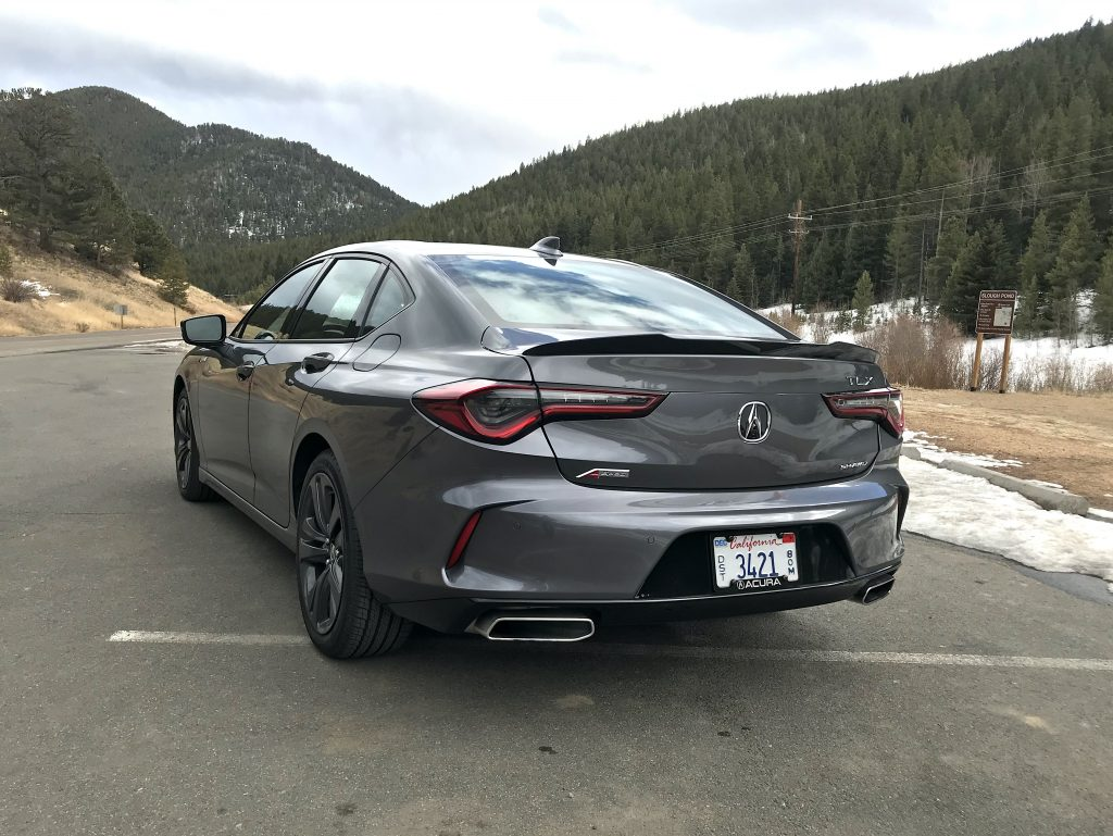 A rear shot of the 2021 Acura TLX A-Spec next to a mountain for our full review