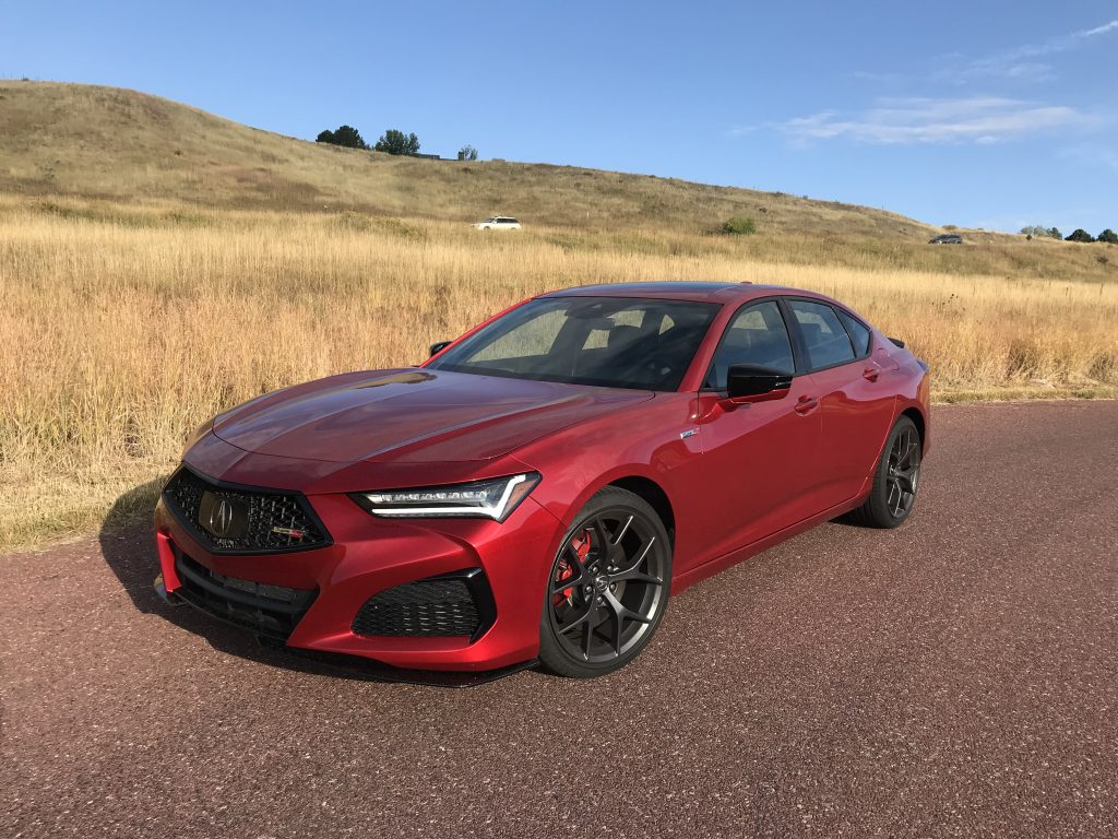 A front shot of the 2021 Acura TLX Type S next to a field for our full review