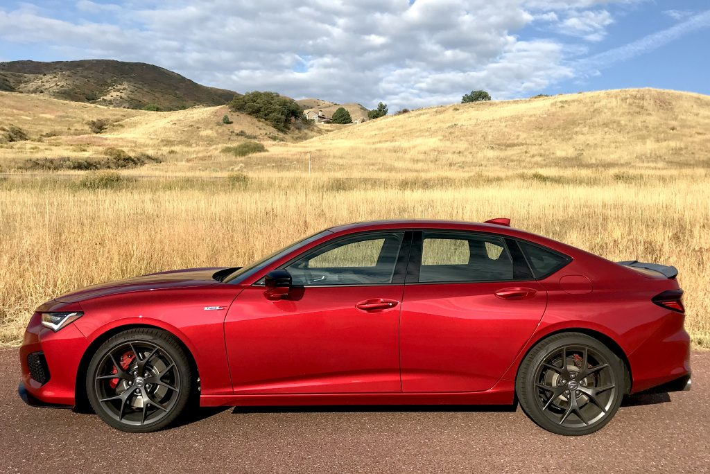 A side shot of the 2021 Acura TLX Type S next to a field for our full review