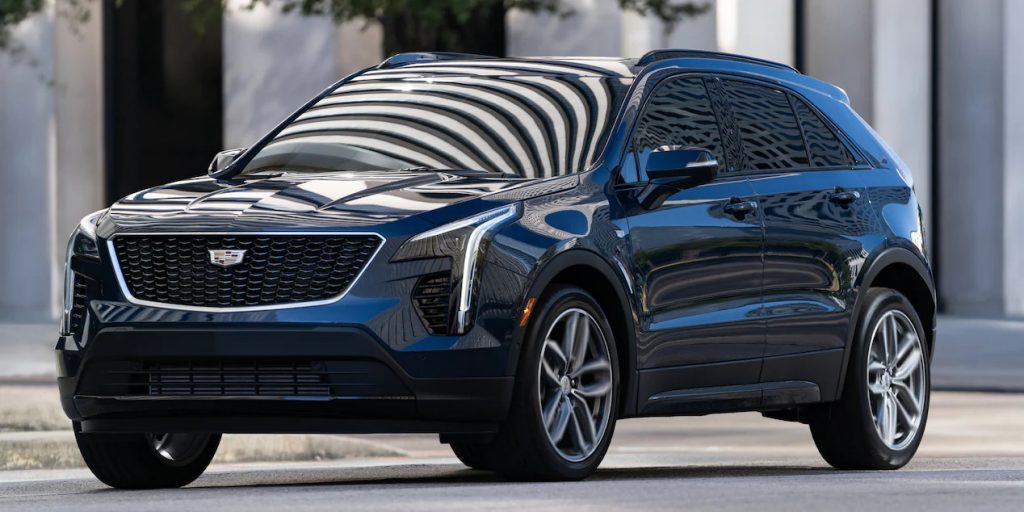 A black 2021 Cadillac XT4 is parked on the side of a road
