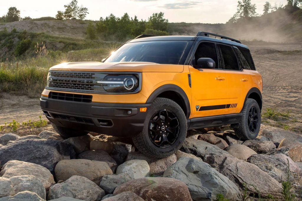A yellow 2021 Ford Bronco Sport parked on some rocks