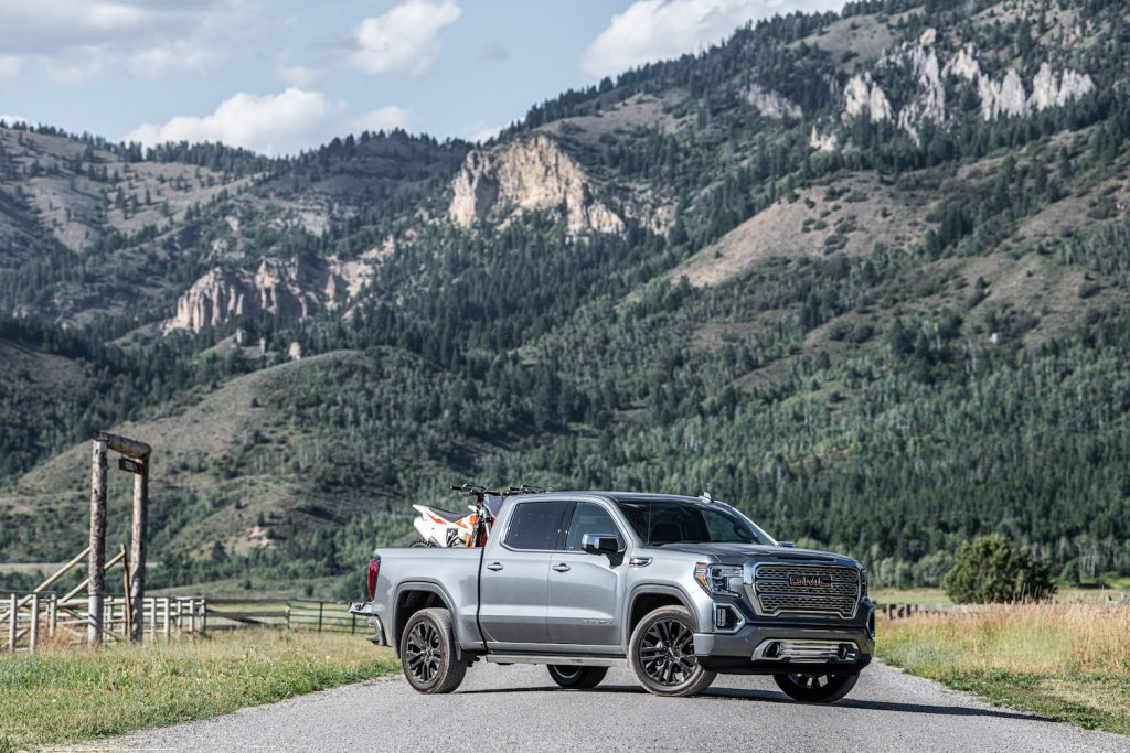 A silver 2021 GMC Sierra Denali in the mountains, the Sierra is the highest-quality truck on the road