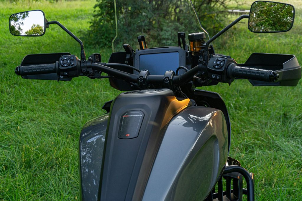 The overhead rear view of a gray-and-black 2021 Harley-Davidson Pan America 1250 Special's handlebars, TFT display, and windscreen