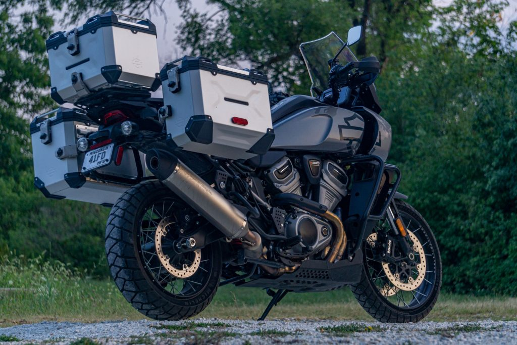 A low-angle rear 3/4 view of a gray-and-black 2021 Harley-Davidson Pan America 1250 Special with accessories