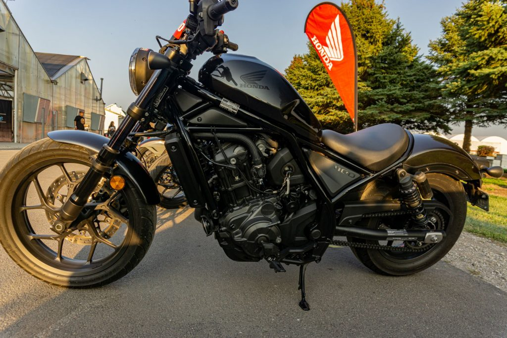 The left side view of a black 2021 Honda Rebel 1100 DCT in a parking lot