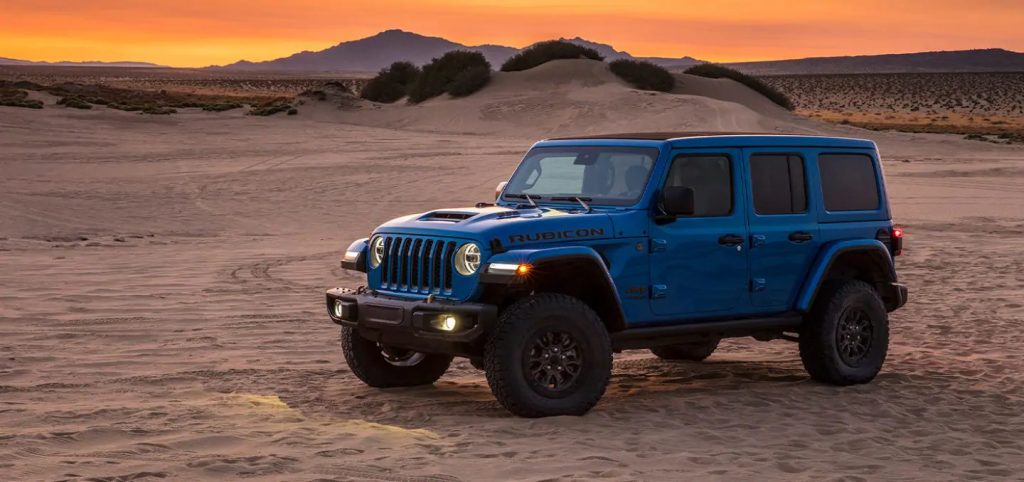 A blue 2021 Jeep Wrangler parked in the desert