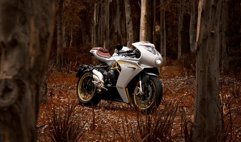 A white-and-gold 2021 MV Agusta Superveloce 800 S in a fall forest