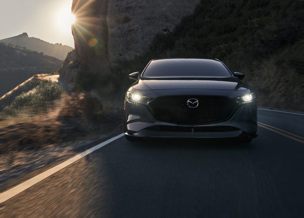 The new Mazda 3, seen here in grey, on a California back road