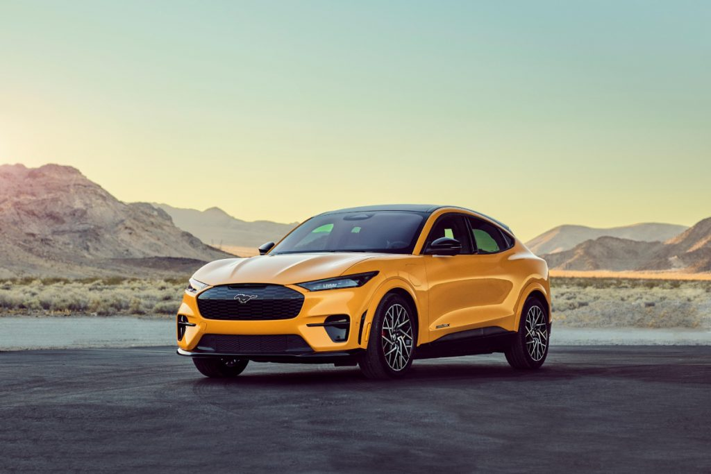 A yellow 2021 Ford Mustang Mach-E on the pavement