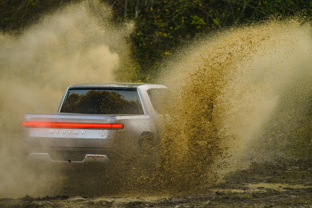 This is a promo photo of a sivler 2022 Rivian R1T offroad. This quad-motor electric pickup easily conquered a difficult Moab trail   Rivian