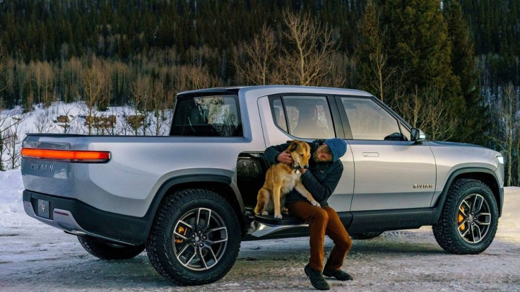 This is a promotional photo of a silver Rivian R1T electric truck. The Rivian electric pickup is the first to market.