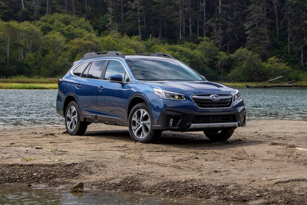 A blue 2021 Subaru Outback parked by water