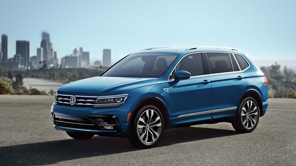 A blue 2021 Volkswagen Tiguan parked outside during the day