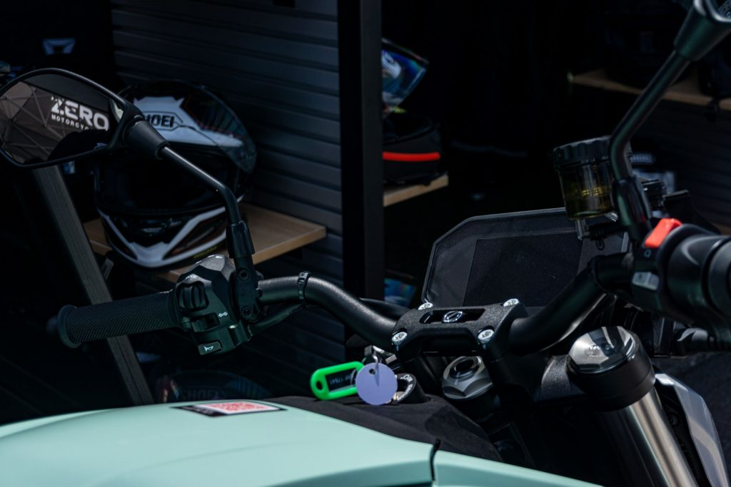 A close-up view of a mint-green 2021 Zero SR/F Premium's handlebars and TFT display