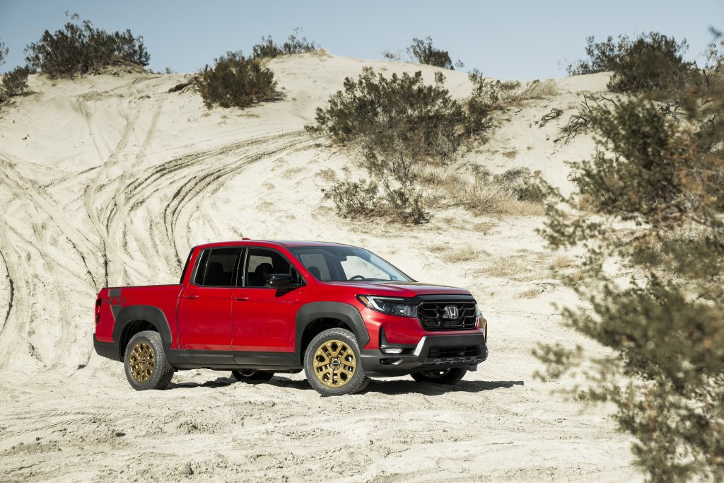 Red Honda Ridgeline parked in the desert. This is the same model and color as we had in our 2021 Honda Ridgeline review