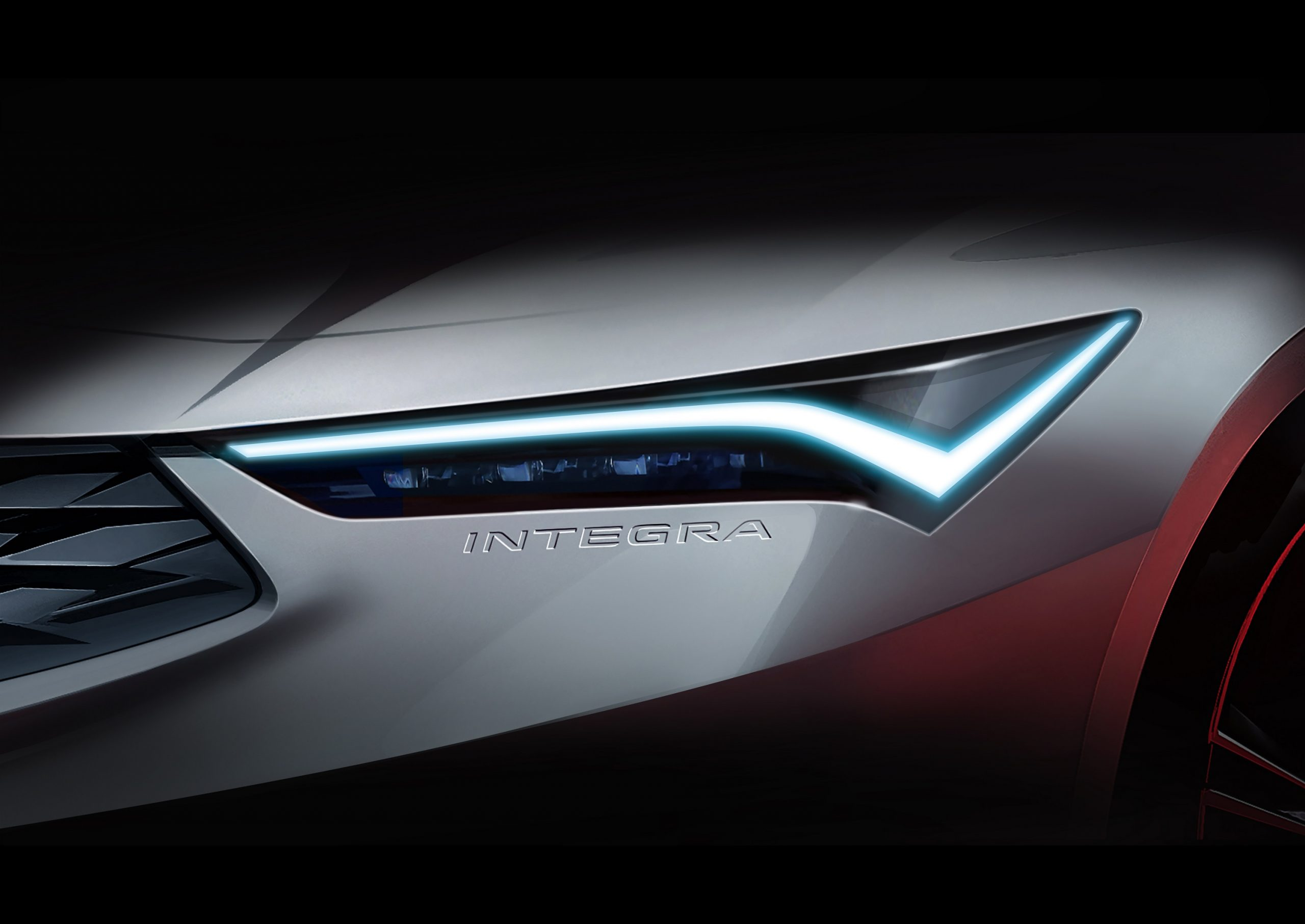The headlight of the new Acura Integra shot close from the front 3/4 angle
