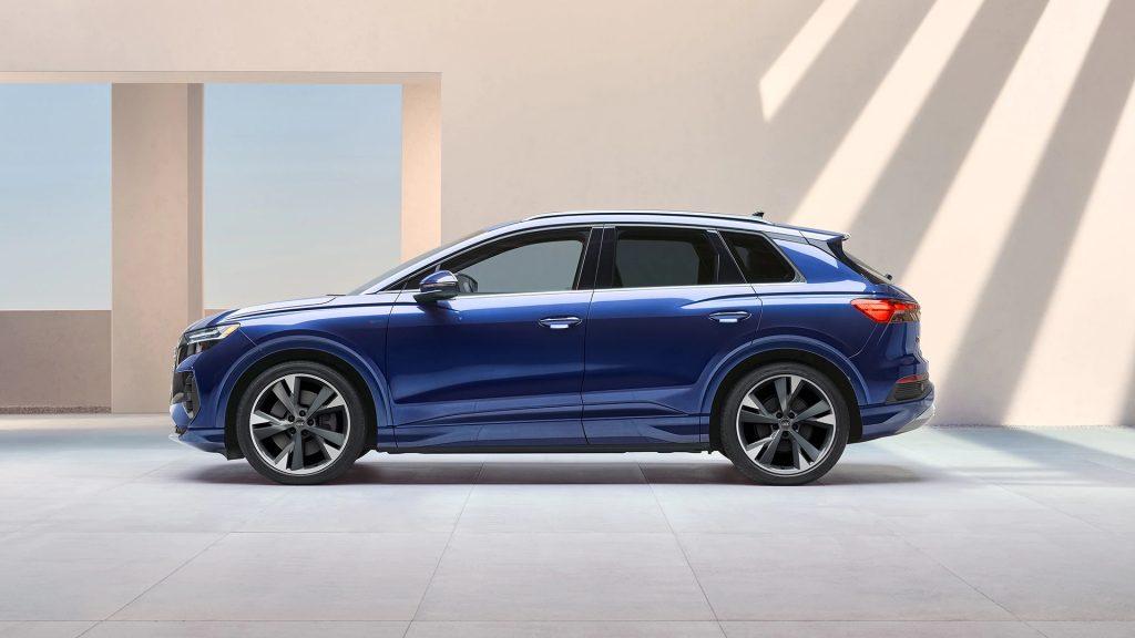 A blue 2022 Audi Q4 e-tron parked near a building