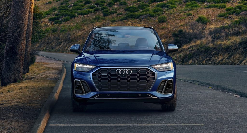 A blue 2022 Audi Q5 is parked on the road.